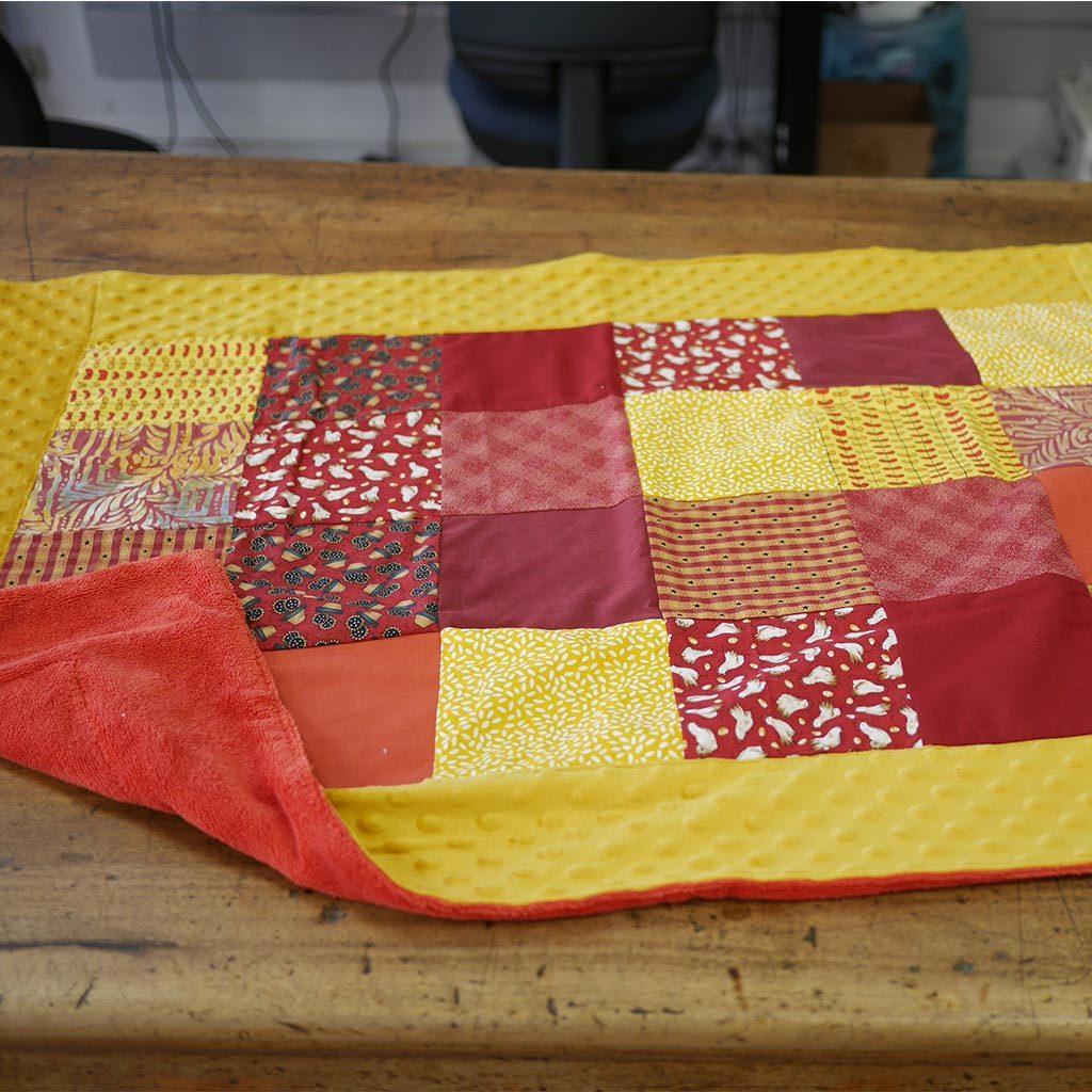 Couverture pour bébé en Polaire bamboo, coton et molky de couleurs chaudes